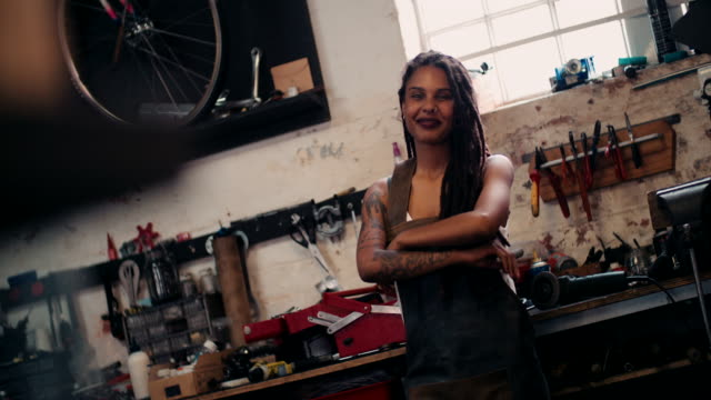 Afro craftswoman standing in her workshop with her tools video