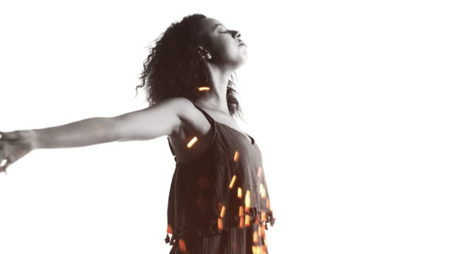 Afro girl with arms raised double exposure with sparkler video