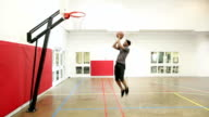 Afro-American 30 years old man playing basketball in a gymnasium video