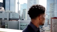 Afro-American business men in front of the Toronto cityscape video