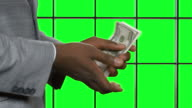 Afroamerican man counting money. video