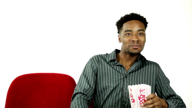 Afro-american man in a theatre isolated on white background video