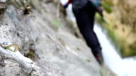 after putting a bolt on a rock , climber is moving on video