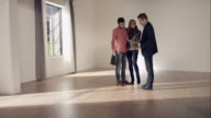Agent presenting new apartment to young couple video