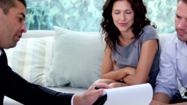 Agent showing contract to couple video
