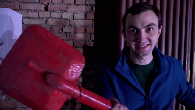 Aggressive man with shovel video