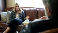 Agitated patient makes a point to therapist video