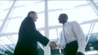 Agreement handshake in bright office video