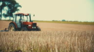 Agricultural tractor sowing and cultivating field video