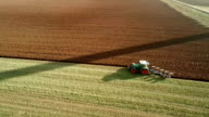 AERIAL: Agriculture - Tractor plowing a field video