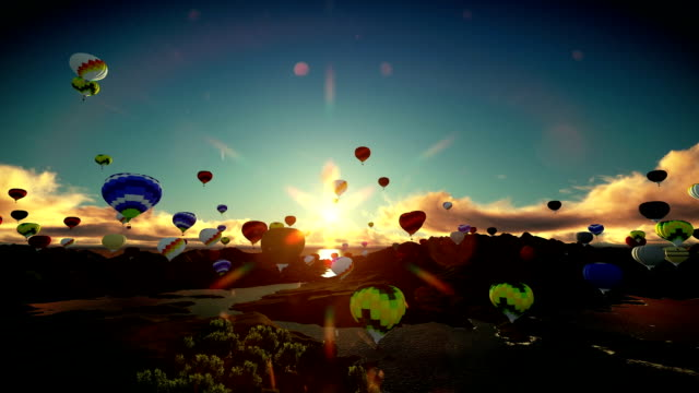Air balloons flying above lake surrounded by mountains, beautiful sunset, travelling shot video