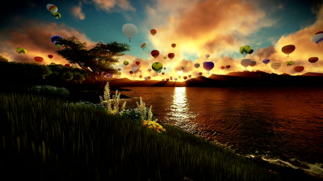 Air balloons flying over beautiful lake and green meadow surrounded by mountains, sunrise video