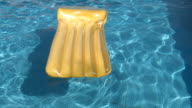 Air bed raft floating on a swimming pool video
