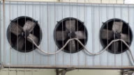 Air conditioner unit fans rotating. video