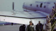 1951: US Air force deplaning from soldiers during Korean War. video