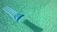 Air mattress floating on swimming pool water video