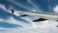 Aircraft passenger airline wing blue sky soft clouds HD video