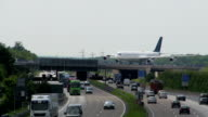Aircraft rolled over the motorway bridge video