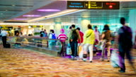 Airline passengers walking in the airport terminal video