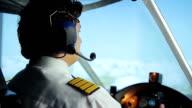 Airliner crew commander navigating plane in blue sky, passenger transportation video