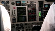 Airplane cockpit controls with pilots talking video