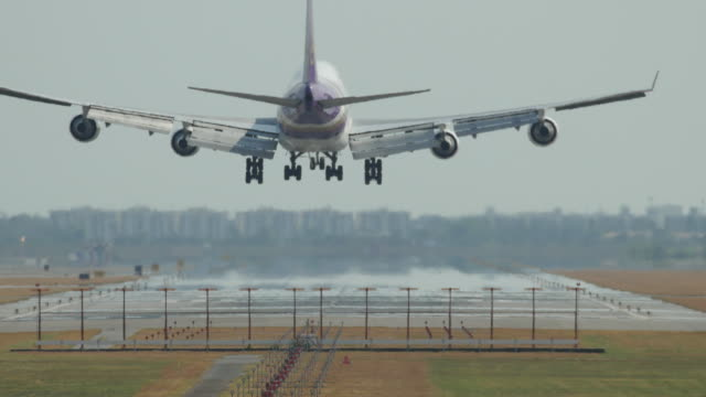 Airplane flying over head near airport video