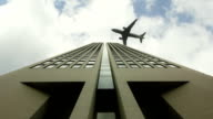 Airplane flying over the office building video