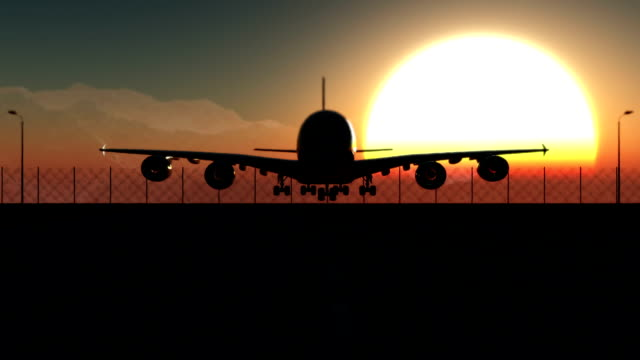Airplane landing at sunset video