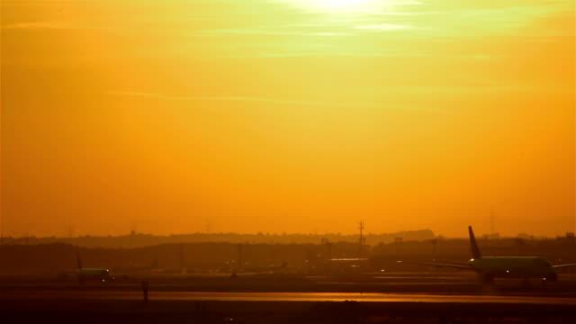 Airplane landing at sunset video