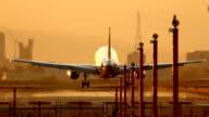 HD airplane landing at sunset video