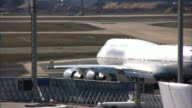 Airplane moving to take-off position, airport runway (HD, PAL, NTSC) video