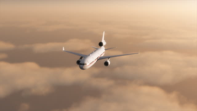 Airplane over sunset clouds. video
