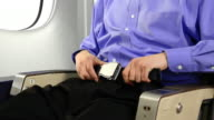 Airplane Passenger Buckling His Seatbelt video