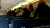 Airplane Passengers Disembarking Tilt Shift video