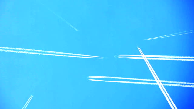 Airplane passing, condense trail remaining. video