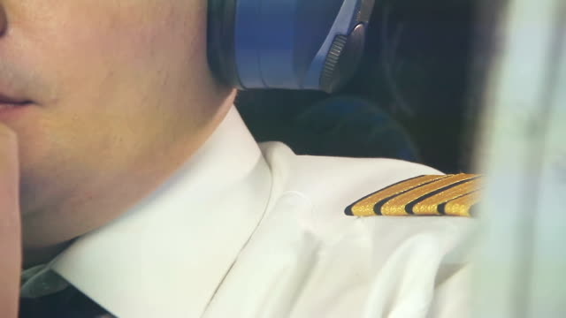 Airplane pilot talking over radio in cockpit, reporting situation to dispatcher video