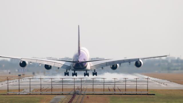 airplane plane landing in airport thailand video