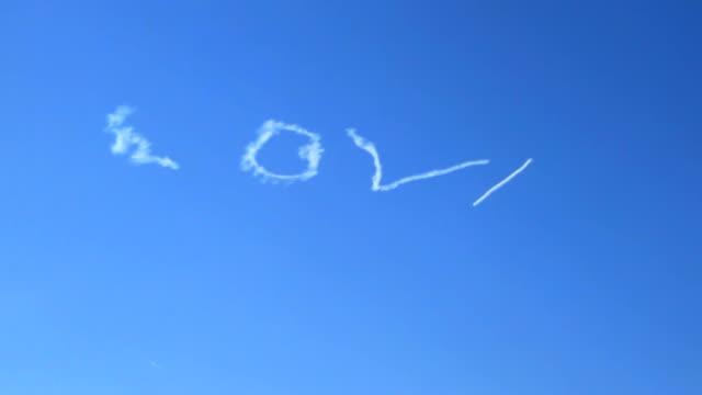 Airplane skywriter writes love video