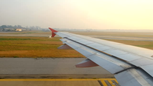 Airplane taxiing on runway at airport in morning. video