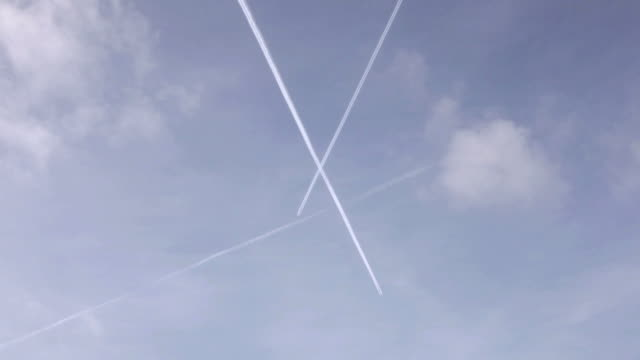 Airplane vapor trails in the sky video