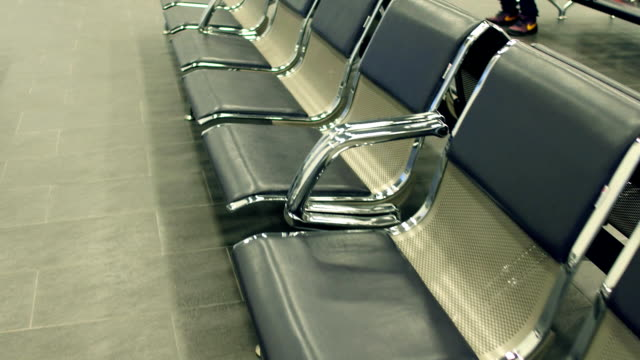Airport or railway station lounge emty seats. Waiting concept. FullHD steadicam shot video