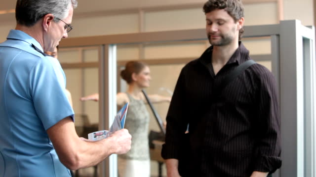Airport security person checks passports and tickets video