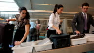 Airport travelers at security screening video