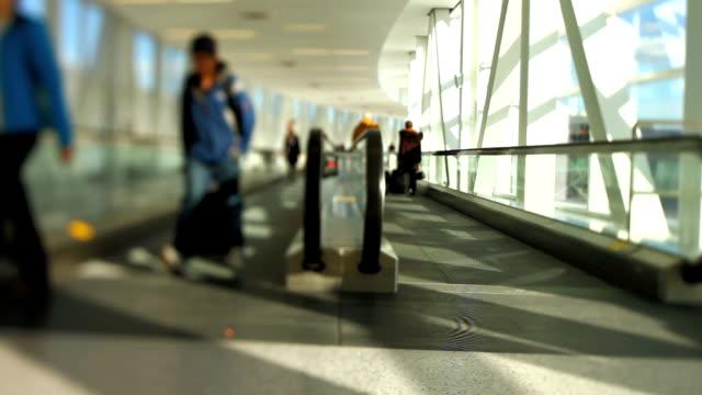 Airport Travelers Moving Walkway Tilt Shift video