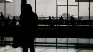Airport with passenger silhouettes video