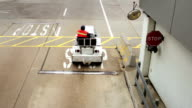 Airport workers on motorized vehicles video