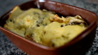al forno pancake with chicken and mushrooms at table video