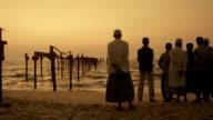 Alappuzha beach, south india, men contemplating sea at sunset video