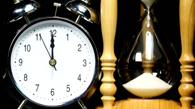 Alarm clock and Hourglass - Time Lapse video