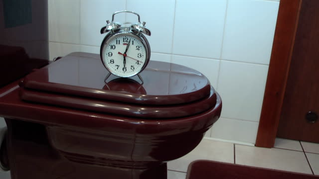 Alarm Clock on the Toilet Bowl recalls taking care of health video